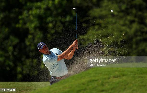 Matt Kuchar plays a ahot from a bunker on the seventh hole during the final round of the Sony Open In Hawaii at Waialae Country Club on January 18...