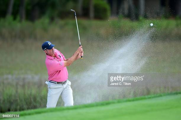Matt Kuchar plays a shot from a greenside bunker on the 17th hole during the third round of the 2018 RBC Heritage at Harbour Town Golf Links on April...