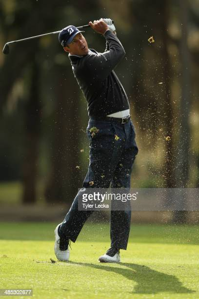 Matt Kuchar plays a shot on the 13th fareway during the first round of the RBC Heritage at Harbour Town Golf Links on April 17 2014 in Hilton Head...