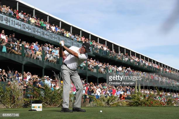 Matt Kuchar plays a tee shot on the 16th hole during the final round of the Waste Management Phoenix Open at TPC Scottsdale on February 5, 2017 in...