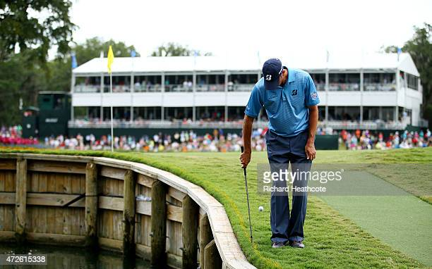 Matt Kuchar plays his second shot on the 17th hole backwards during round two of THE PLAYERS Championship at the TPC Sawgrass Stadium course on May...