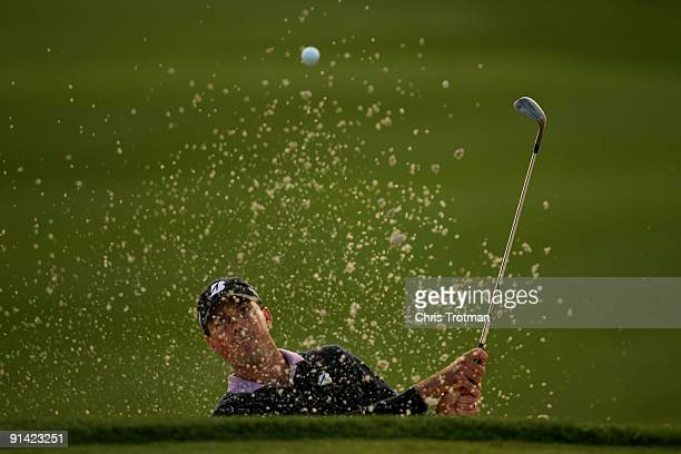Matt Kuchar plays out of the bunker on the 18th hole at the 2009 Turning Stone Resort Championship at Atunyote Golf Club held on October 4, 2009 in...