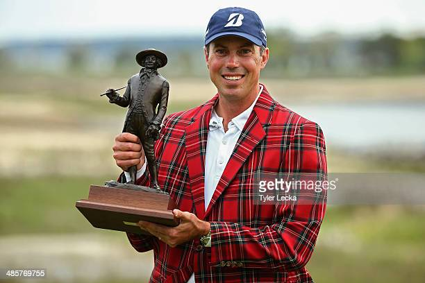 Matt Kuchar poses with his trophy on the 18th green after winning the RBC Heritage at Harbour Town Golf Links on April 20 2014 in Hilton Head Island...
