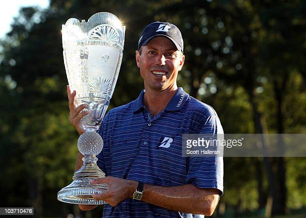 Matt Kuchar poses with the trophy after winning The Barclays at the Ridgewood Country Club on August 29 2010 in Paramus New Jersey