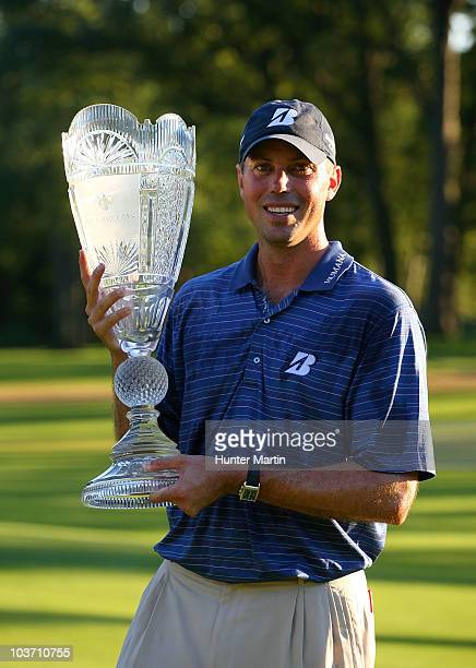 Matt Kuchar poses with the trophy after winning The Barclays at the Ridgewood Country Club on August 29 2010 in Paramus New Jersey Kuchar won on a...
