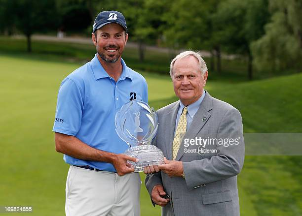 Matt Kuchar poses with the trophy and tournament host Jack Nicklaus after Kuchar's twostroke victory at the Memorial Tournament presented by...