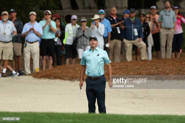 Matt Kuchar reacts after playing a shot from a bunker on the second hole during the final round of the 2018 RBC Heritage at Harbour Town Golf Links...