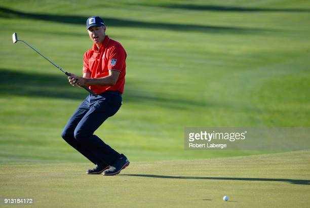 Matt Kuchar reacts to a missed birdie putt on the 14th hole during the first round of the Waste Management Phoenix Open at TPC Scottsdale on February...