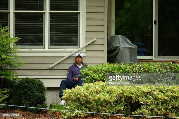 Matt Kuchar seeks shelter from the rain near the second hole during the second round of the RBC Heritage at Harbour Town Golf Links on April 18 2014...