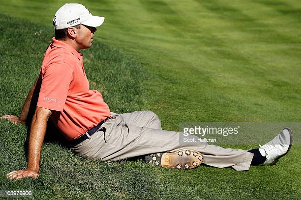 Matt Kuchar sits on on the fringe of the 11th green for Charley Hoffman to putt during the second round of the BMW Championship at Cog Hill Golf...