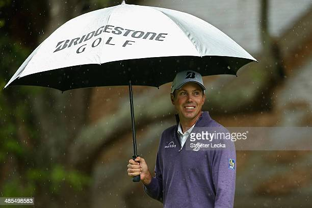 Matt Kuchar stands under his umbrella at the 2nd tee box during the second round of the RBC Heritage at Harbour Town Golf Links on April 18 2014 in...