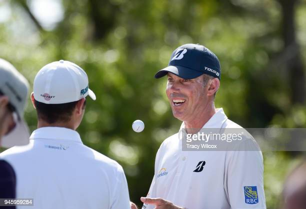 Matt Kuchar talks with Wesley Bryan during the second round of the RBC Heritage at Harbour Town Golf Links on April 13 2018 in Hilton Head South...