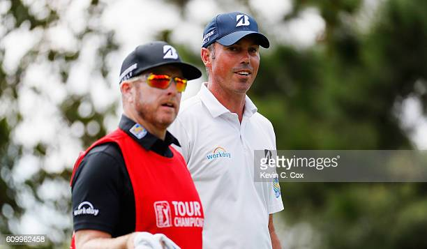 Matt Kuchar waits with his caddie John Wood on the first hole during the second round of the TOUR Championship at East Lake Golf Club on September 23...