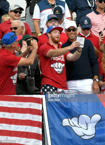Matt Kuchar with the US Team poses with fans during the second round of the Presidents Cup at Liberty National Golf Club on September 29 in Jersey...