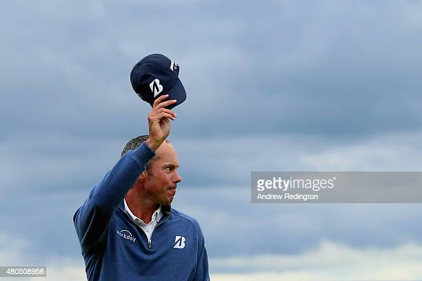 Matt Kucher of the United States waves on the 18th green after completing his final round of the Aberdeen Asset Management Scottish Open at Gullane...