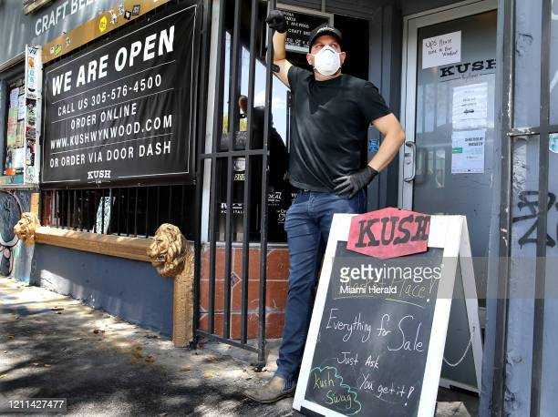 "Matt ""Kush"" Kusher stands outside his restaurant KUSH in Wynwood, Miami, Fla., April 29, 2020. Kusher and other restaurant owners are struggling..."
