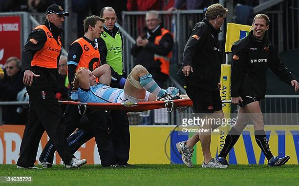 Matt Kvesic of Worcester is carried off the field after picking up an injury during the AVIVA Premiership match between match between Exeter Chiefs...