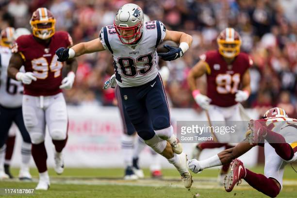Matt LaCosse of the New England Patriots leaps to avoid a tackle by Montae Nicholson of the Washington Redskins during the first half at FedExField...