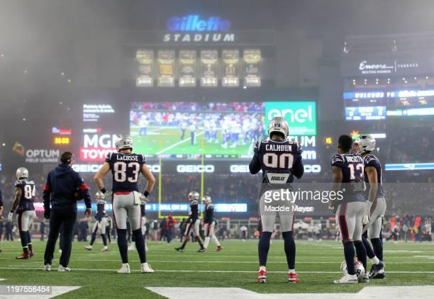 Matt LaCosse, Shilique Calhoun, Phillip Dorsett of the New England Patriots and teammates watch the Buffalo Bills v Houston Texans game on the...