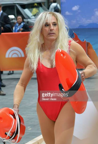 Matt Lauer dressed as Pamela Anderson's 'Baywatch' character C J Parker attends NBC's 'Today' Halloween 2013 in Rockefeller Plaza on October 31 2013...