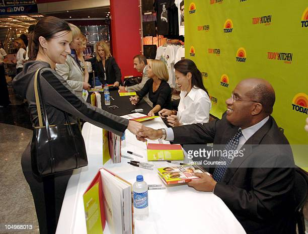 Matt Lauer Katie Couric Ann Curry and Al Roker sign copies of their new book Today's Kitchen Cookbook for the public at the NBC Experience Store at...
