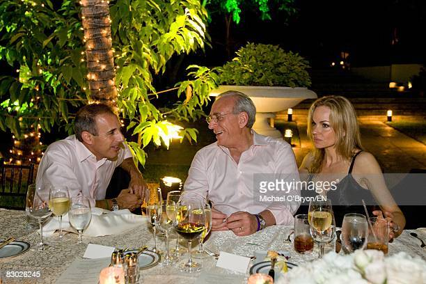 Matt Lauer Nelson Peltz and Claudia Peltz visit during the wedding of Golfpro Greg Norman and former tennispro Chris Evert at the One and Only Ocean...