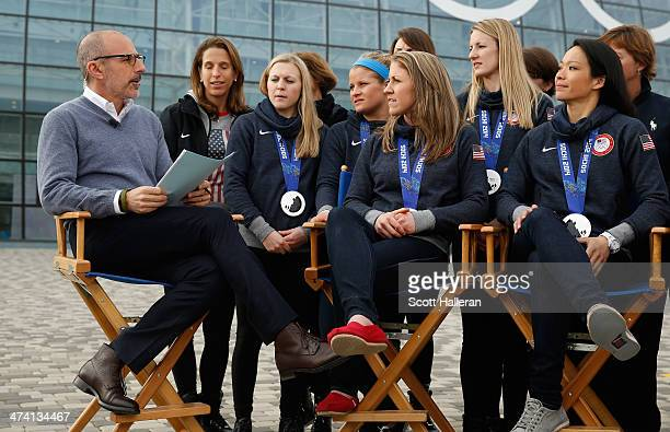 Matt Lauer of the NBC TODAY Show speaks with members of the USA Women's Hockey team in the Olympic Park during the Sochi 2014 Winter Olympics on...
