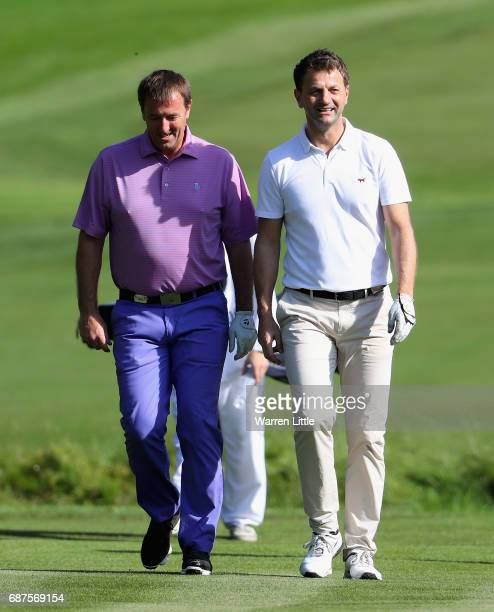 Matt Le Tissier and Tim Sherwood walk down the 4th fairway during the BMW PGA Championship ProAM at Wentworth on May 24 2017 in Virginia Water England