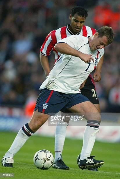 Matt Le Tissier of England XI holds off the challenge of Tahar El Khalej of Southampton during the Matt Le Tissier Testimonial match played between...