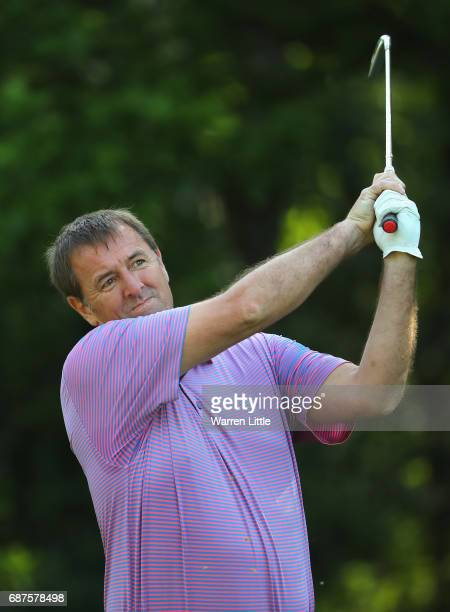 Matt Le Tissier plays an iron shot during the BMW PGA Championship ProAM at Wentworth on May 24 2017 in Virginia Water England