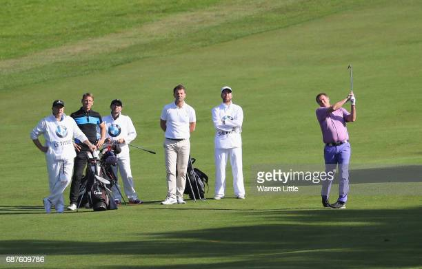 Matt Le Tissier plays his second shot on the 4th during the BMW PGA Championship ProAM at Wentworth on May 24 2017 in Virginia Water England