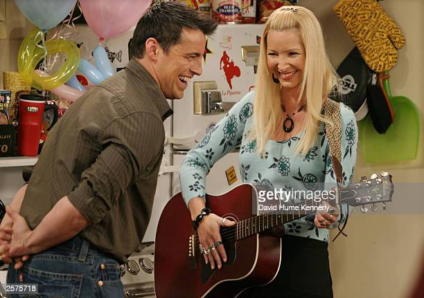 Matt LeBlanc and Lisa Kudrow crack each other up on the set of the hit NBC series Friends during one of the last shows filmed on the Warner Bros lot...