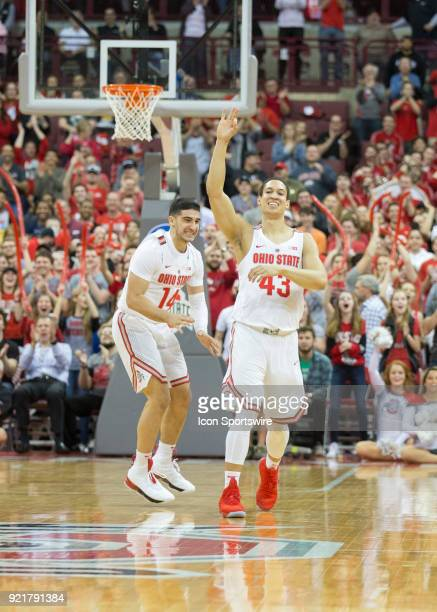Matt Lehmann of the Ohio State Buckeyes and Joey Lane of the Ohio State Buckeyes celebrate a victory after the game between the Ohio State Buckeyes...