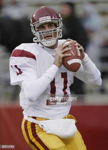 Matt Leinart of the USC Trojans looks to pass during the game against the Washington State Cougars on November 30 2004 at Martin Stadium in Pullman...
