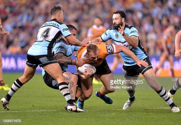 Matt Lodge of the Broncos takes on the defence during the round 20 NRL match between the Brisbane Broncos and the Cronulla Sharks at Suncorp Stadium...