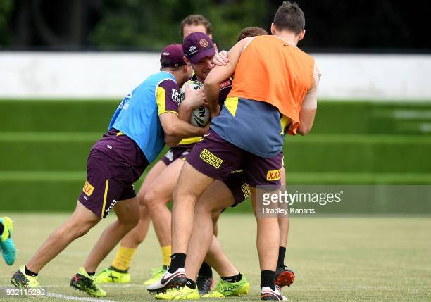Matt Lodge takes on the defence during the Brisbane Broncos NRL training session on March 15 2018 in Brisbane Australia
