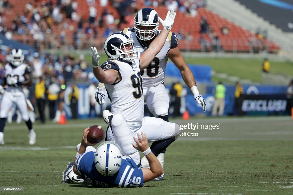 Matt Longacre #96 of the Los Angeles Rams celebrates after sacking Scott Tolzien #16 of the Indianapolis Colts during the fourth quarter at the Los Angeles Memorial Coliseum on September 10, 2017 in Los Angeles, California.