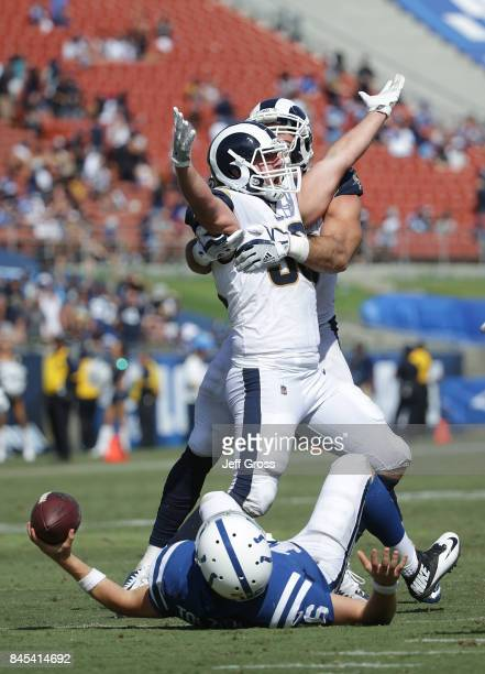 Matt Longacre of the Los Angeles Rams is congratulated by teammate Connor Barwin after sacking Scott Tolzien of the Indianapolis Colts during the...