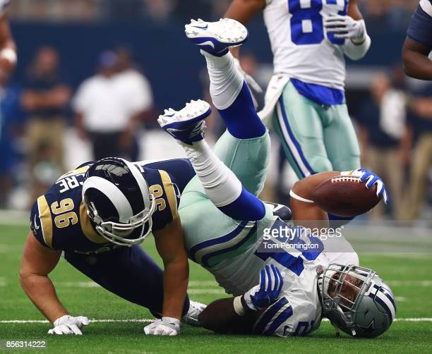 Matt Longacre of the Los Angeles Rams tackles Ezekiel Elliott of the Dallas Cowboys in he first quarter of a football game at ATT Stadium on October...