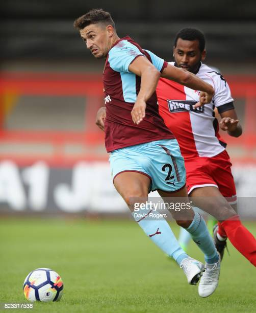 Matt Lowton of Burnley runs with the ball during the pre season friendly match between Kidderminster Harriers and Burnley at Aggborough Stadium on...