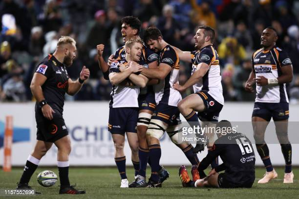 Matt Lucas of the Brumbies celebrates with team mates after scoring a try during the Super Rugby Quarter Final match between the Brumbies and the...