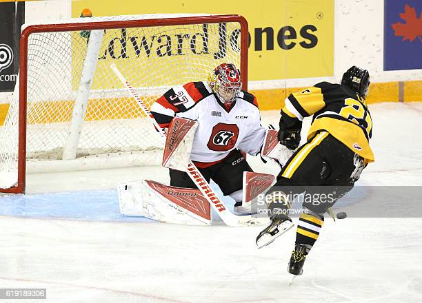 Matt Luff of the Hamilton Bulldogs shoots to score on a penalty shot against Leo Lazarev of the Ottawa 67's in Ontario Hockey League Game at TD Place...