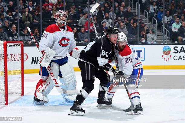 Matt Luff of the Los Angeles Kings and Jeff Petry of the Montreal Canadiens battle for position as goaltender Carey Price of the Montreal Canadiens...
