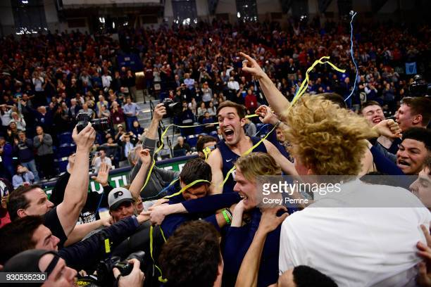 Matt MacDonald of the Pennsylvania Quakers celebrates winning the Men's Ivy League Championship Tournament with teammates at The Palestra on March 11...