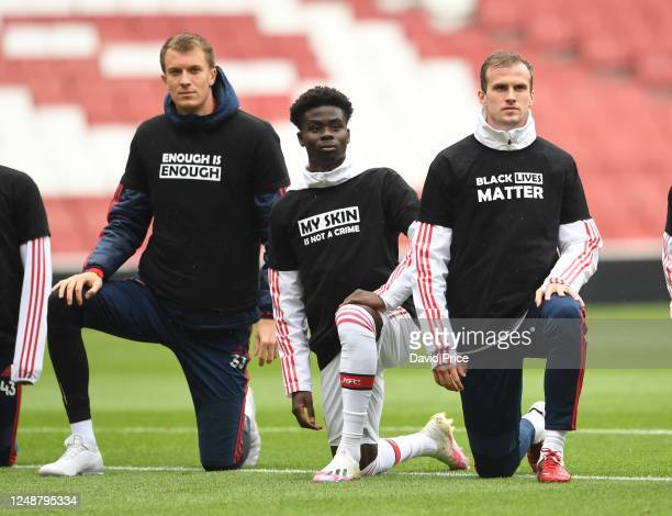 Matt Macey Bukayo Saka and Rob Holding of Arsenal take a knee in support of Black Lives Matter before the friendly match between Arsenal and...
