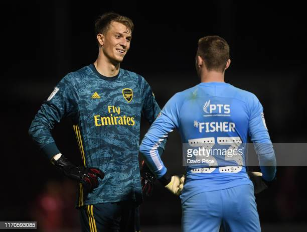 Matt Macey of Arsenal chats to Andrew Fisher of Northampton before the penalty shoot out after the Leasingcom match between Northampton Town and...