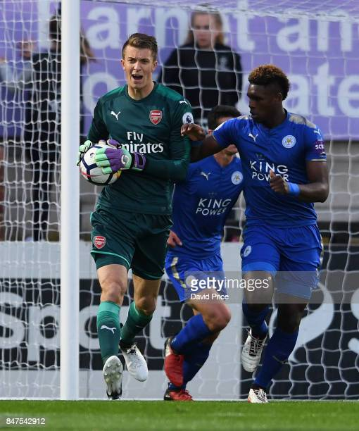 Matt Macey of Arsenal is challenged by Darnell Johnson of Leicester during the match between Arsenal U23 and Leicester City U23 at Meadow Park on...