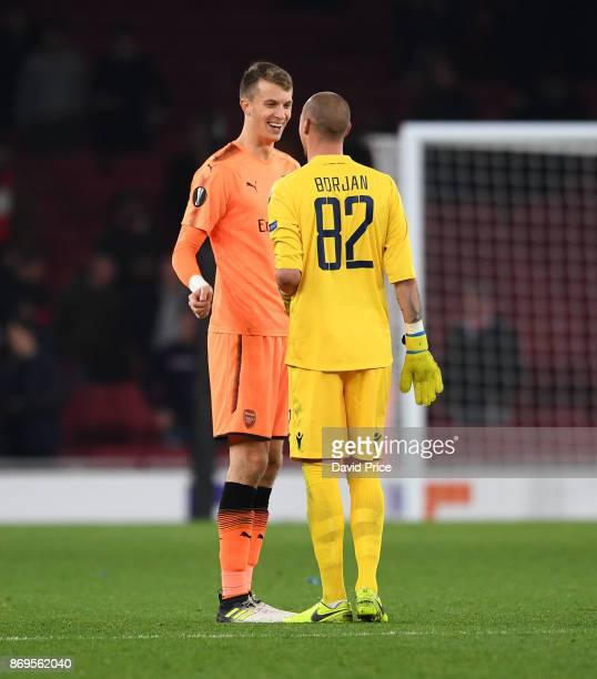Matt Macey of Arsenal with Ricardinho of Red Star after the UEFA Europa League group H match between Arsenal FC and Crvena Zvezda at Emirates Stadium...