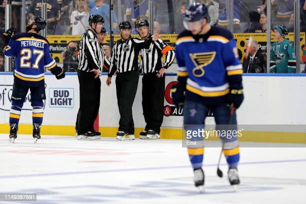 Matt MacPherson linesman Jonny Murray and referee Dan O'Rourke discuss a possible hand pass game winning overtime goal scored by Erik Karlsson of the...