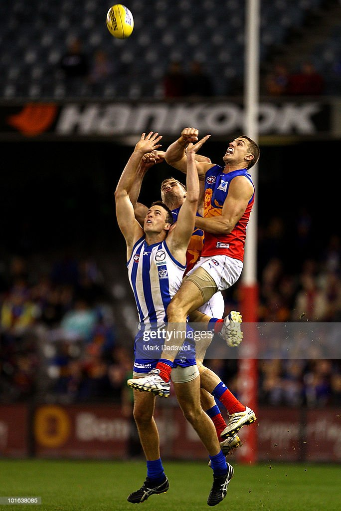Matt Maguire of the Lions punches the ball clear of Hamish McIntosh of the Kangaroos during the round 11 AFL match between the North Melbourne Kangaroos and the Brisbane Lions at Etihad Stadium on June 5, 2010 in Melbourne, Australia.